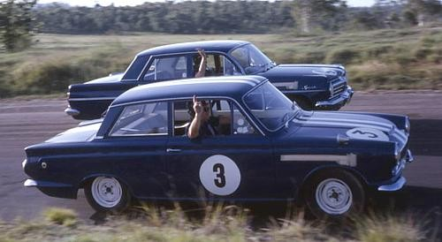 How much did motor racing improve the production car breed in the 1960s and 1970s?
